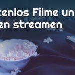 Frau isst Popcorn und streamt Filme und Serien kostenlos